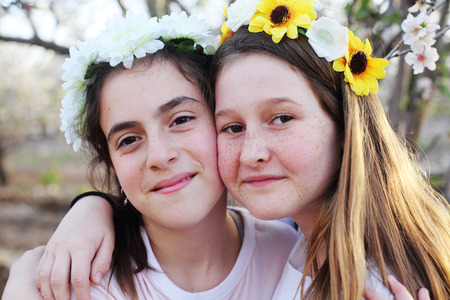 Portrait of two teenage girlfriends  outdoors Stock fotó