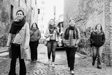 Women best friends smiling and walking at the city.