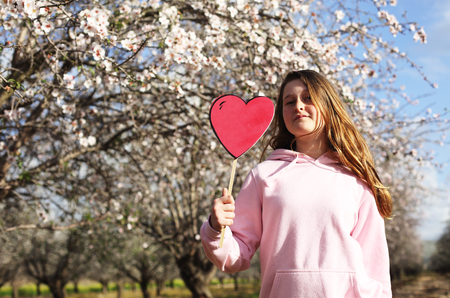 12 years old girl holding red shape heart