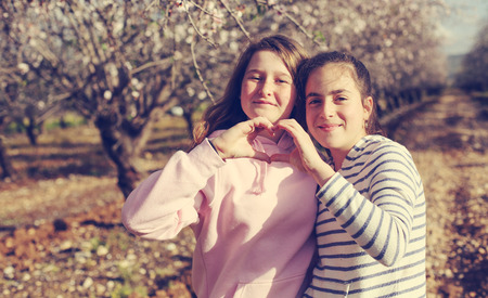 Two teenage girlfriends  outdoors Stock fotó