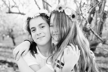 Portrait of two teenage girlfriends  outdoors Imagens