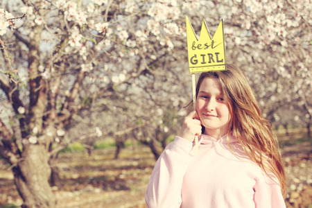 12 years old girl holding crown shape