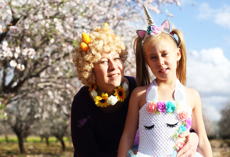 Outdoor portrait of mother and daughter in carnival costume Stock fotó