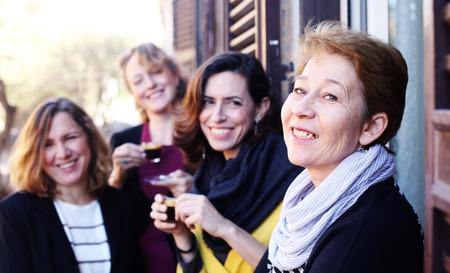 Women best friends smiling, drinking morning coffee 免版税图像