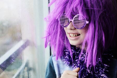 happy emotional autist boy in carnival costume at home