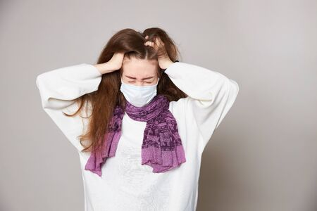 Girl in medical mask on white background empty space
