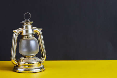 Coal miners lamp on black and yellow background