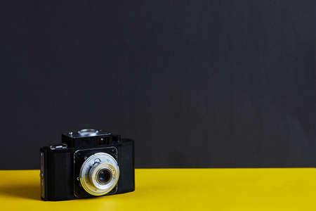 Film cameras that had been popular in the past on black and yellow background