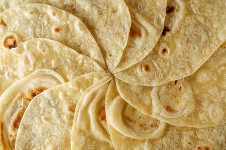 Mexican tortilla wrap background or texture top view. Food flatbread pattern. Banco de Imagens