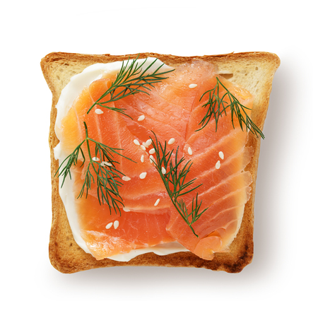 Wholegrain toast with salmon and cheese on white background top view, isolated.