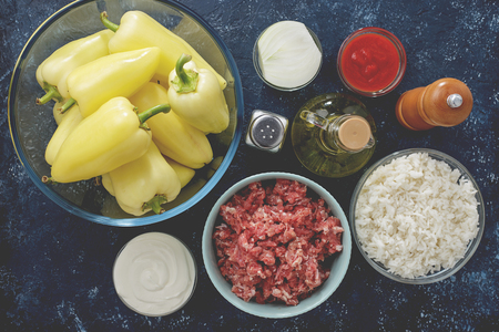 Fresh ingredients for cooking of homemade stuffed pepper on kitchen table top view.