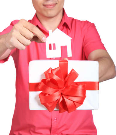 give out: parts of hands with house and white gift with red bow isolated on white background
