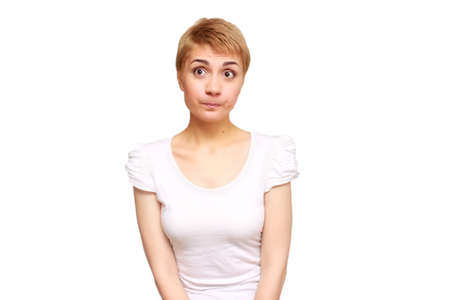 portrait skeptical, upset young woman looking suspicious, disgust on face, mixed disapproval, isolated white background. Negative human emotion, facial expression, feeling, attitude Stock Photo