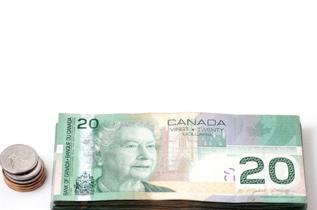 canadian coin: Twenty Canadian dollars notes and stack of coins