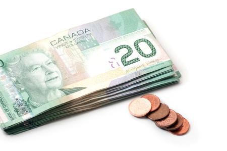 canadian coin: Twenty Canadian dollars bills and pennies