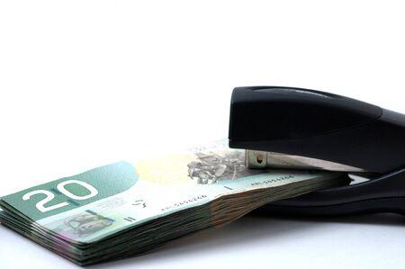 Twenty Canadian dollars and stapler Banco de Imagens