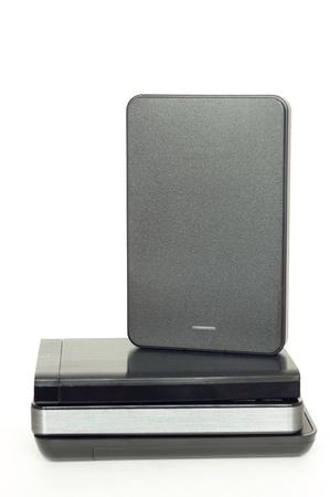 Pile of four external USB hard drives photo