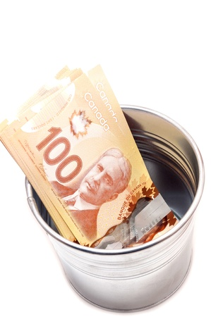 Hundred Canadian dollar bills in an aluminium  pot Stock Photo - 20015850
