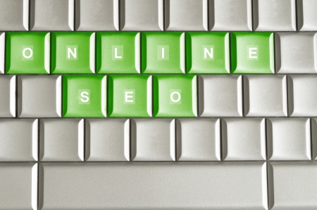 Conceptual word ONLINE SEO isolated on a keyboard photo