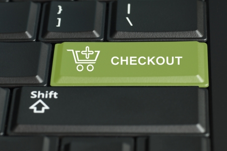 checkout: Concept of checkout action of an online transaction  The focus is on the enter key with the shift button on the bottom