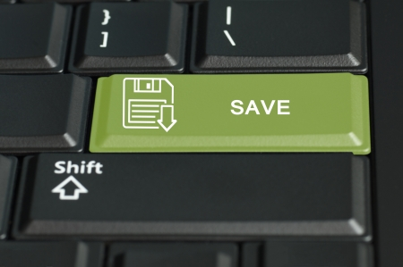 technology transaction: Concept of save  action   The focus is on the enter key with the shift button on the bottom