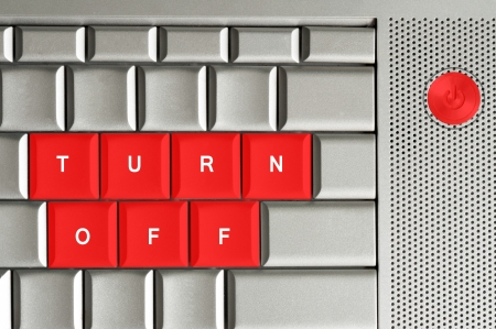 scamming: Turn off in red on a metallic keyboard Stock Photo