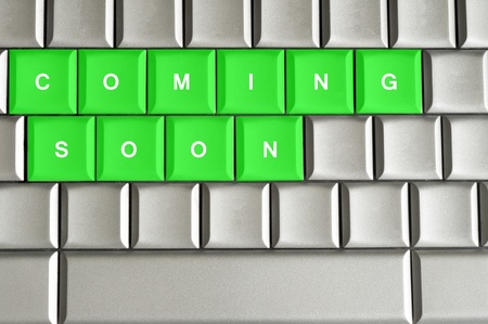Coming Soon spelled on a silver metallic keyboard photo