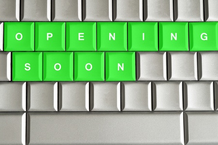 Opening Soon spelled on a silver metallic keyboard Reklamní fotografie - 20417293