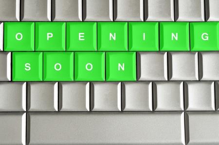 Opening Soon spelled on a silver metallic keyboard Stock Photo