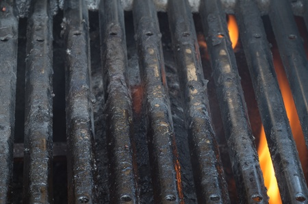 Dirty barbecue grills and flames