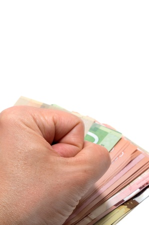 pounding: Hand pounding on a series of Canadian banknotes Stock Photo