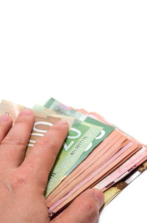 stash: Hand hiding the stash of Canadian banknotes