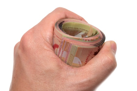 Hand holding a roll of 50 dollars Canadian  photo