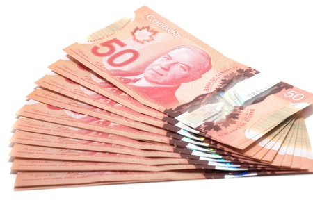 Selective focus of a series of 50 Canadian dollars on white background photo