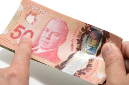 Finger pointing the 50 Canadian dollars  photo