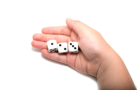 Hand holding three dices on white background photo