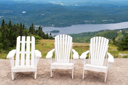 lounge: Chairs on top of mountain  at a ski resort during summer time depicting relaxing concept Stock Photo