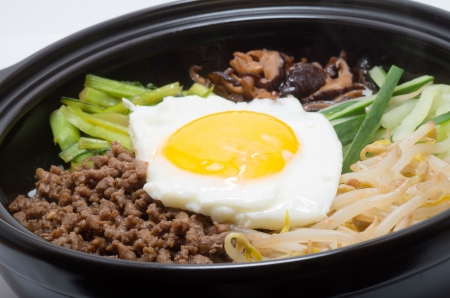 Korean traditional bibimbap in a clay pot photo