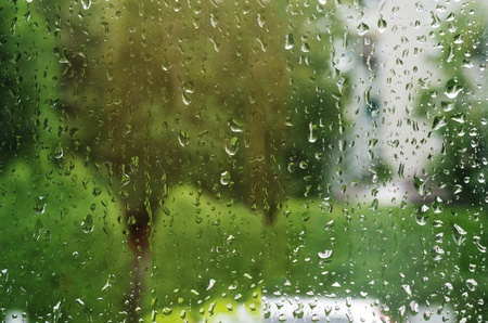 Macro shot of rain water drops on windows - selective focus