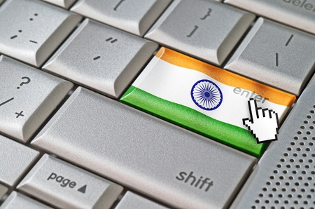 Business concept mouse cursor pressing India enter key on metallic keyboard photo