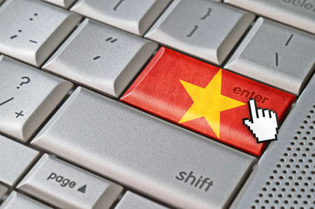 Business concept mouse cursor pressing Vietnam enter key on metallic keyboard photo