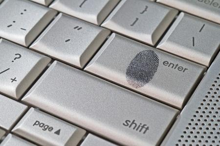 handed: Fingerprint left on keyboard hack concept Stock Photo