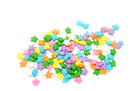 Multi colors stars candy on white background photo