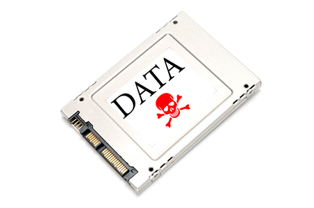 ssd: Concept hacked data drive showing a SSD with a red skull on it