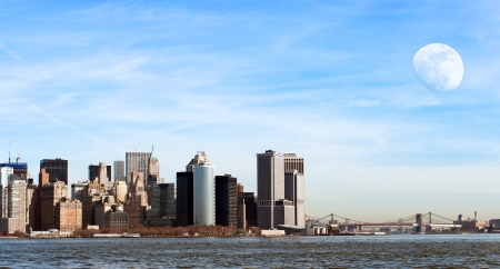 Manhattan cityscape with almost full moon during a sunny day photo