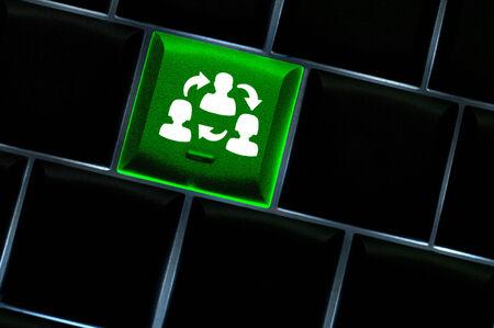 Online collaboration Concept with back lit keyboard Imagens