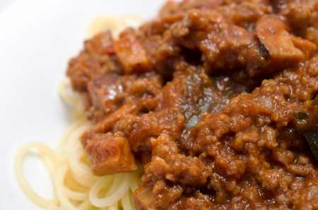 Closeup Spaghetti with a Bolognese and vegetable sauce.