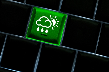 Online weather Concept with back lit keyboard photo