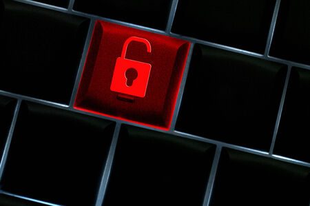 hack: Online hack concept with unlock icon on backlit laptop keyboard