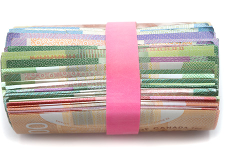 Side view of a Roll of Canadian banknotes wraped with a pink rubber band photo